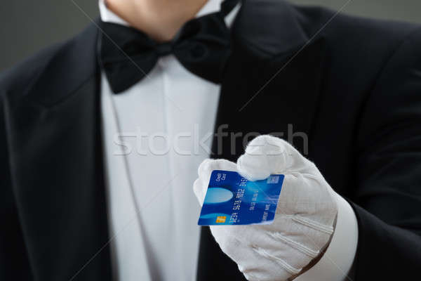 Midsection Of Waiter Holding Credit Card Stock photo © AndreyPopov