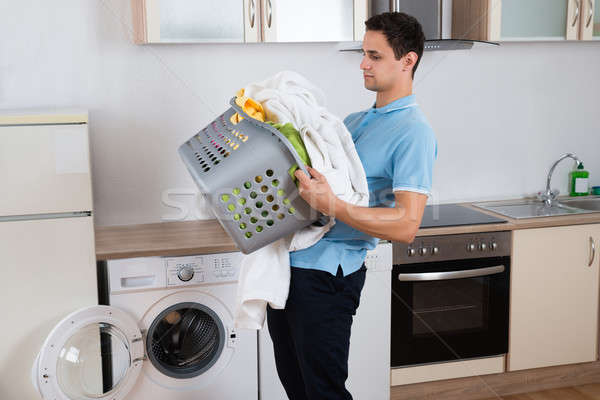 Man Carrying Heavy Laundry Basket Stock photo © AndreyPopov