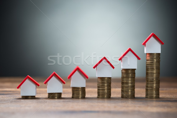 House Models Arranged On Stacked Coins Stock photo © AndreyPopov