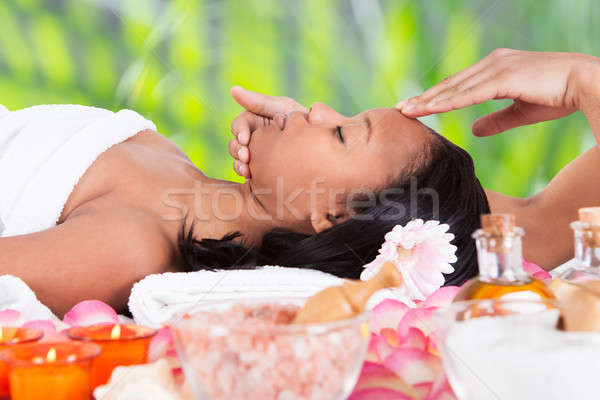 Woman Receiving Head Massage From Massager Stock photo © AndreyPopov