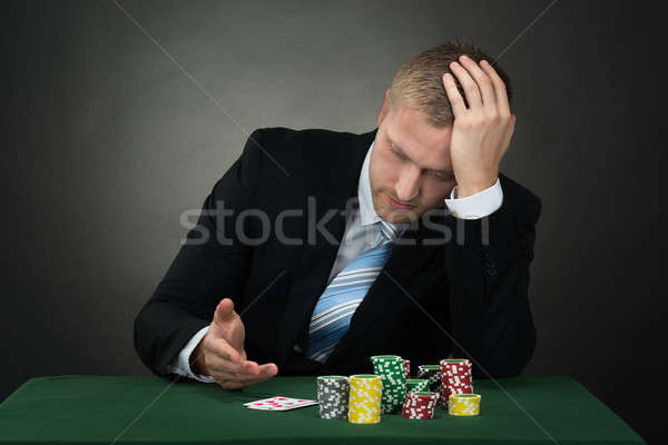 Portrait Of A Depressed Young Male Poker Player Stock photo © AndreyPopov