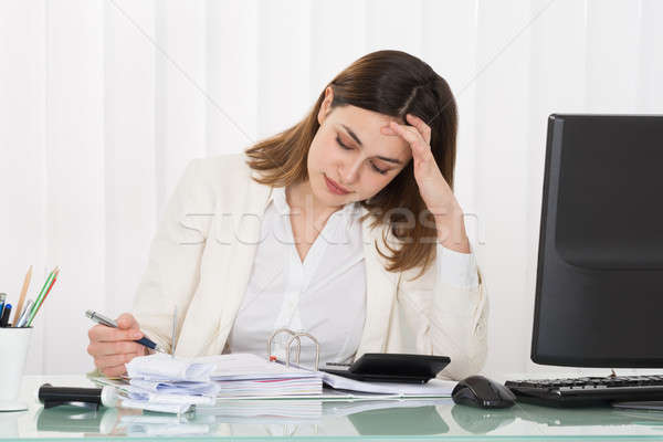 Depressed Businesswoman Calculating Invoice Stock photo © AndreyPopov