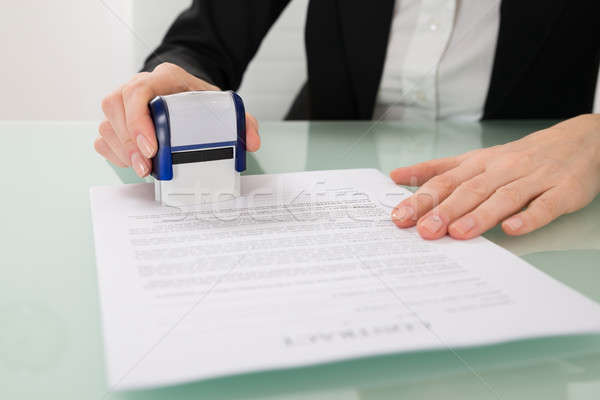 Businesswoman Stamping Contract Paper Stock photo © AndreyPopov