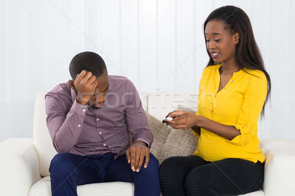 Sad Expectant Couple Sitting On Sofa Stock photo © AndreyPopov