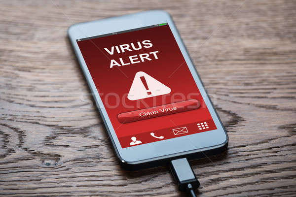 Mobile Phone With Virus Infected Stock photo © AndreyPopov