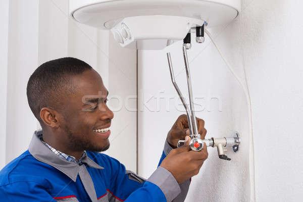 Plumber Repairing Electric Boiler Stock photo © AndreyPopov