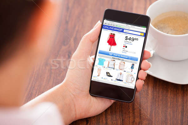 Stock photo: Person Doing Online Shopping On Mobilephone