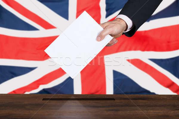 Empresário votar cédula caixa mão Reino Unido Foto stock © AndreyPopov