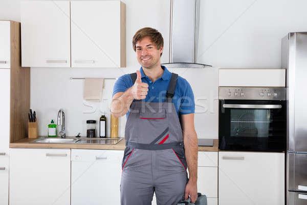 Szczęśliwy młodych pracownika przybornik portret Zdjęcia stock © AndreyPopov