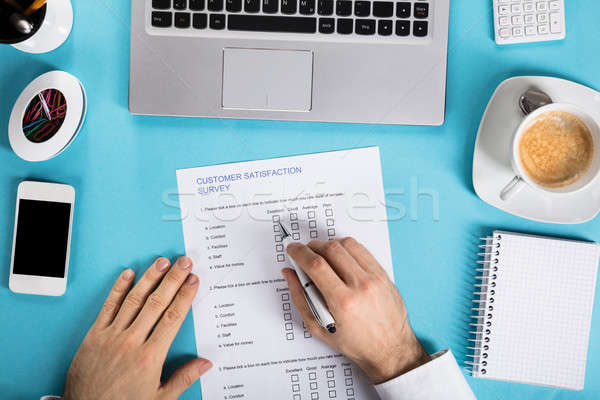 Businessman Filling The Customer Satisfaction Survey Form Stock photo © AndreyPopov
