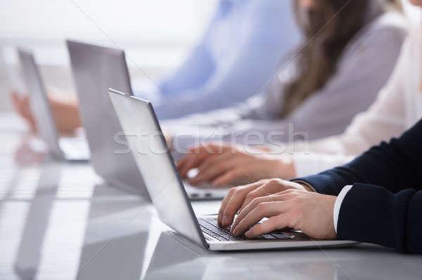 Hands On Laptop Keypad Stock photo © AndreyPopov