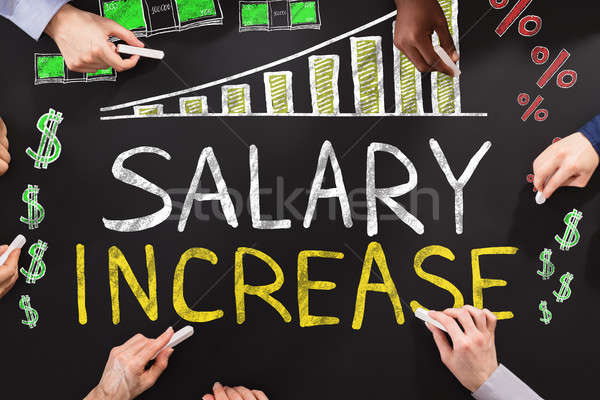 Salary Increase Drawing On Blackboard Stock photo © AndreyPopov