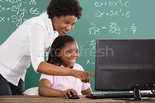 Tanár tanít diák osztály mosolyog afrikai Stock fotó © AndreyPopov
