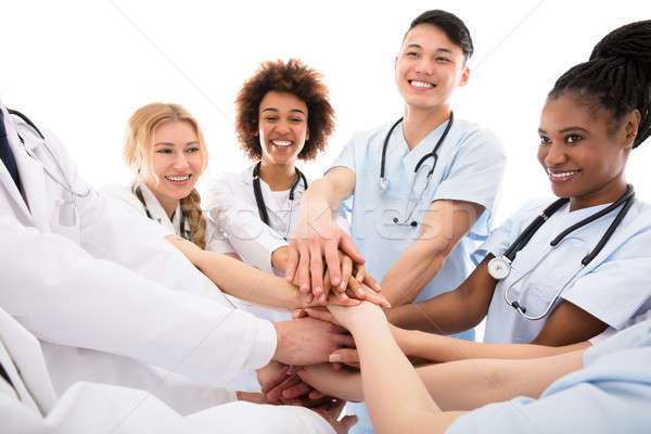 Group Of Doctors Stacking Their Hands Stock photo © AndreyPopov