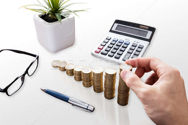 Close-up Of A Businessperson Stacking Coins Stock photo © AndreyPopov