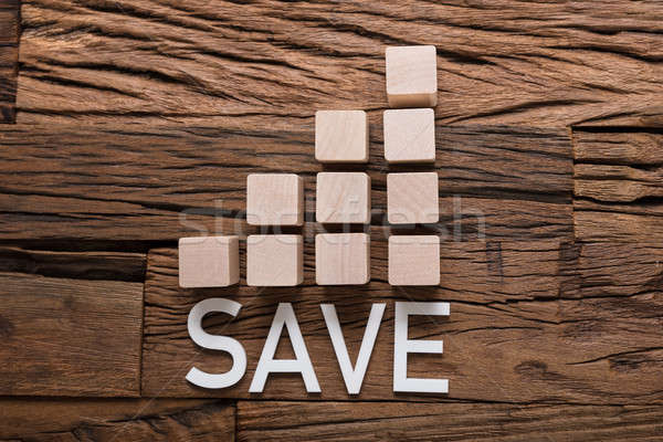 Save Text By Increasing Bar Graph Blocks On Wood Stock photo © AndreyPopov