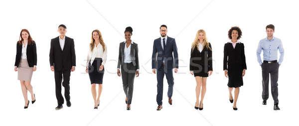 Csoport többnemzetiségű üzletemberek sétál fehér üzlet Stock fotó © AndreyPopov