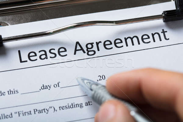 Human Hand Filling Lease Agreement Form Stock photo © AndreyPopov