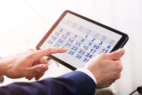 Businessperson Using Calendar On Digital Tablet Stock photo © AndreyPopov