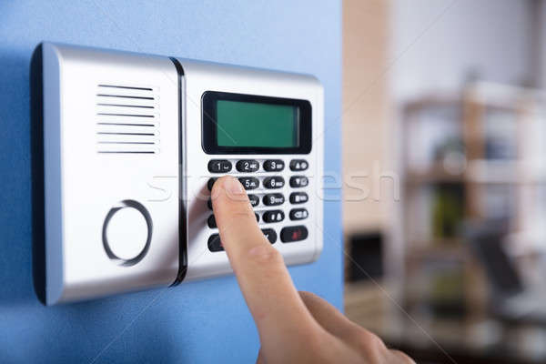 Person's Finger Entering Code In Security System Stock photo © AndreyPopov