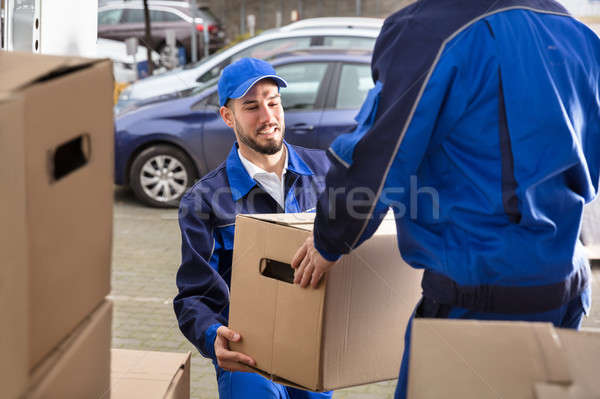 Mover Holding Cardboard Box Stock photo © AndreyPopov
