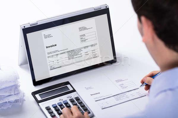 Işadamı fatura melez dizüstü bilgisayar hesap makinesi Stok fotoğraf © AndreyPopov