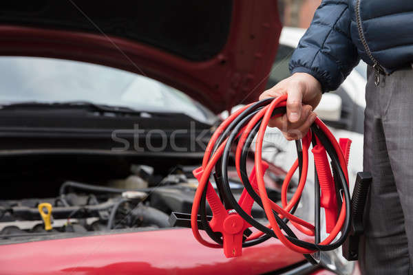 Close-up Of A Person Holding Jumper Cables Stock photo © AndreyPopov