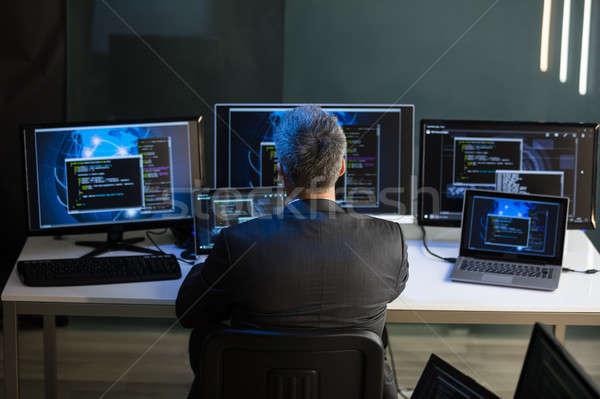 бизнесмен глядя множественный компьютер вид сзади работу Сток-фото © AndreyPopov