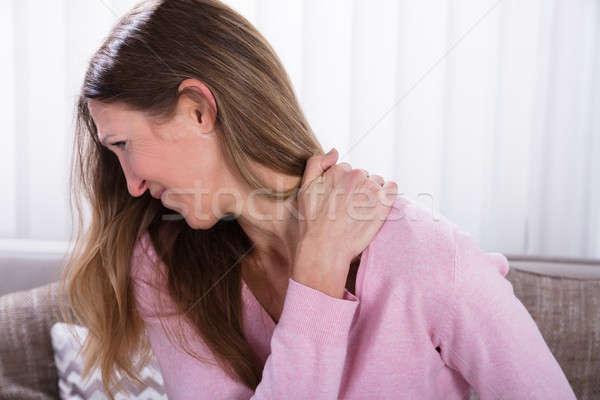 Olgun kadın sırt ağrısı kadın ev Stok fotoğraf © AndreyPopov
