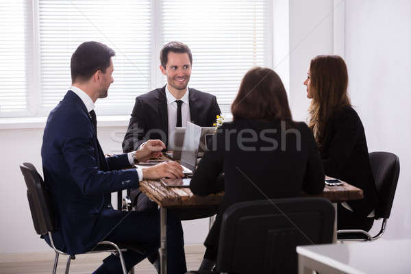 Businesspeople Attending Meeting In Office Stock photo © AndreyPopov