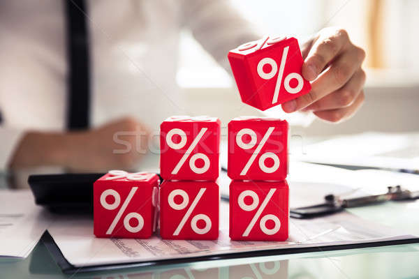 Businessperson Building Cubic Blocks With Percentage Symbols Stock photo © AndreyPopov