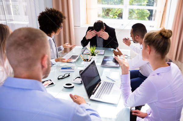 Businesspeople Blaming Their Colleague In Office Stock photo © AndreyPopov