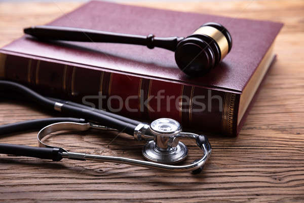 Close-up Of Stethoscope Near Mallet And Law Book Stock photo © AndreyPopov