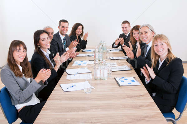 Stock photo: Business Team Sitting At Table And Applauding