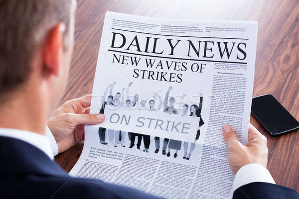 Close-up Of Businessman Reading News On Newspaper Stock photo © AndreyPopov