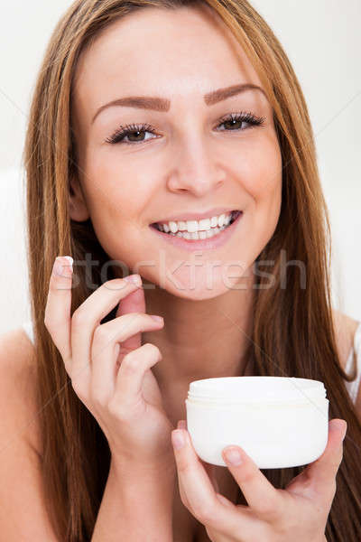 Young Woman Applying Cream Stock photo © AndreyPopov
