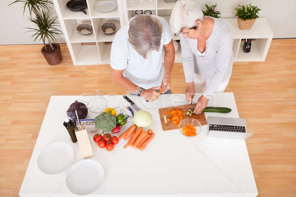 Middle-aged couple preparing a meal Stock photo © AndreyPopov