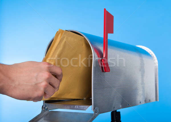 Man opening his mailbox to remove mail Stock photo © AndreyPopov