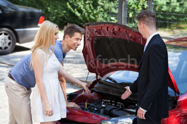 Salesman Showing New Car Engine To Couple Stock photo © AndreyPopov