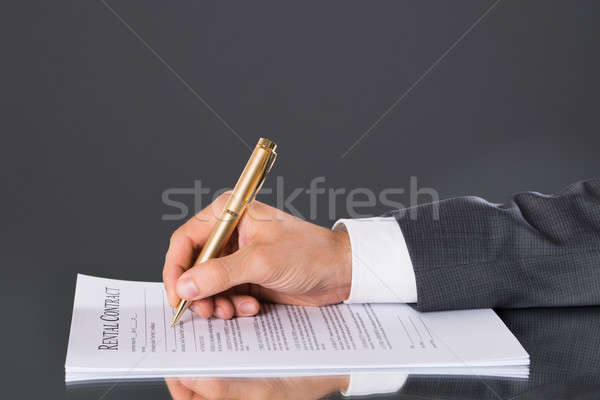 Hand signing business contract Stock photo © AndreyPopov