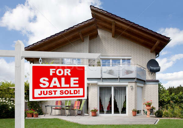 Sold Home For Sale Sign In Front Of House Stock photo © AndreyPopov