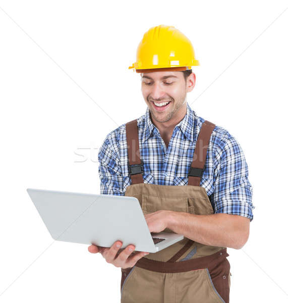 Manual Worker Using Laptop Stock photo © AndreyPopov