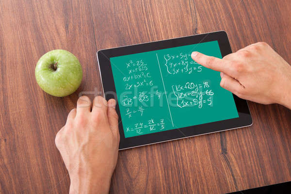 Student Solving Math's Problem On Digital Tablet Stock photo © AndreyPopov