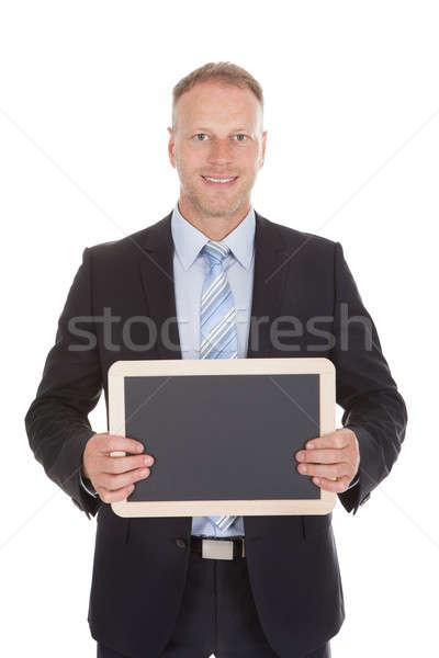 Confident Businessman Holding Blank Slate Stock photo © AndreyPopov