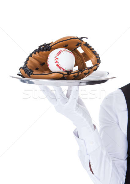Waiter Carrying Baseball And Catcher's Mitt Stock photo © AndreyPopov