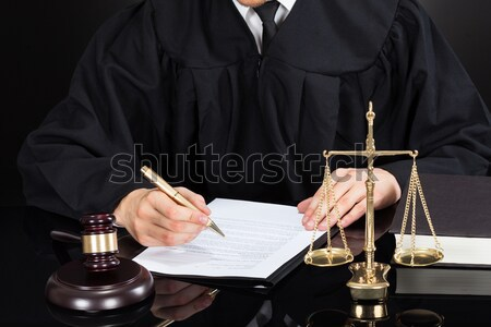 Judge Writing On Paper At Desk Stock photo © AndreyPopov