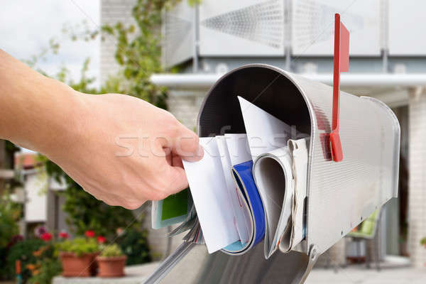 Man Taking Letter From Mailbox Stock photo © AndreyPopov
