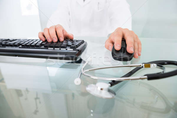 Close-up Of Doctor Using Computer Stock photo © AndreyPopov