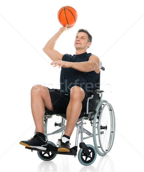 Handicapped Basketball Player Throwing Ball Stock photo © AndreyPopov