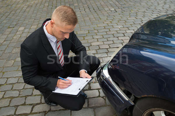 Man Filing Insurance Claim Form Stock photo © AndreyPopov